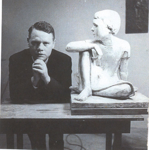 John Berland with early sculpture of his daughter